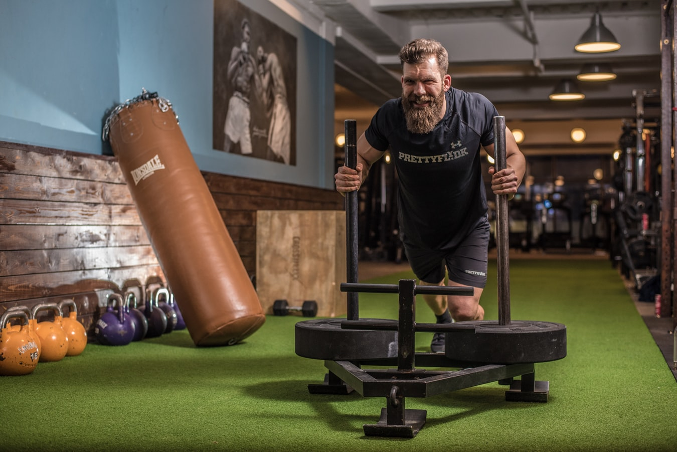 Man pushing prowler as part of strength and conditioning workout